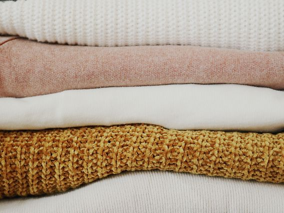 piled-of-folded-textiles-1937336